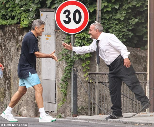 George Clooney out for a jog 43AC5FC600000578-4833002-image-m-83_1504008941288