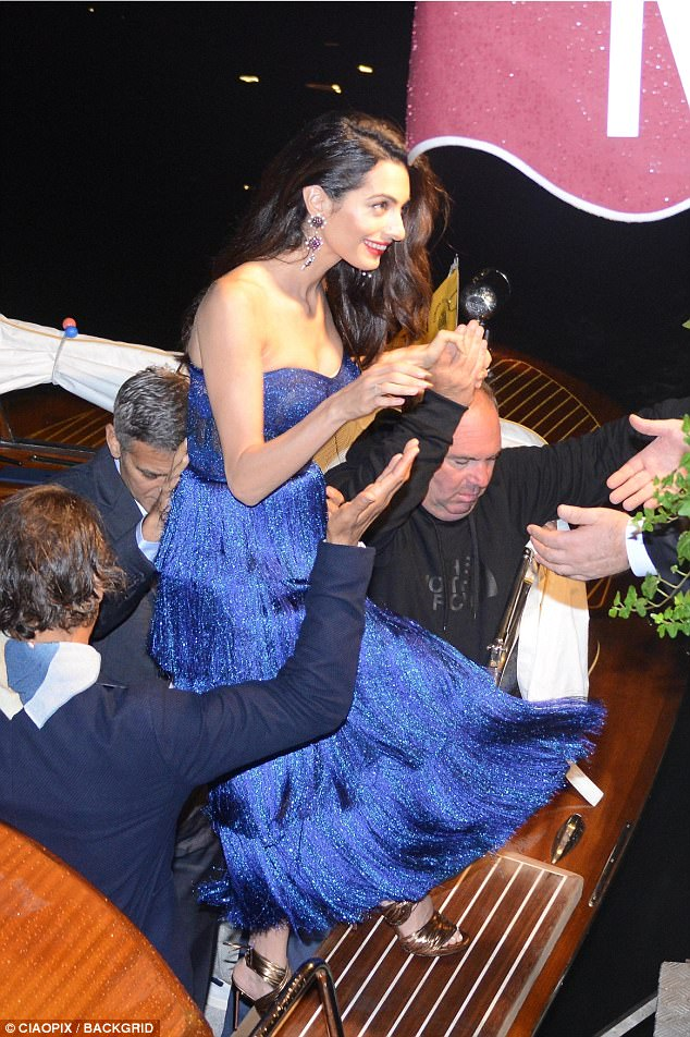 George and Amal and party at Da Ivo Venice tonight 43D0AC7200000578-4846262-image-a-41_1504343322714
