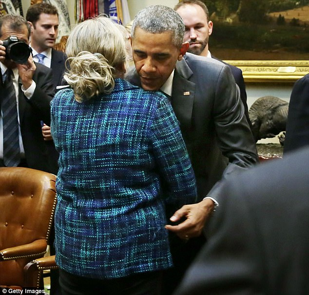 The Serious Side - part 4 - Page 3 456678EF00000578-4986980-President_Barack_Obama_hugs_Gold_Star_mother_Michelle_DeFord_at_-m-5_1508203356059