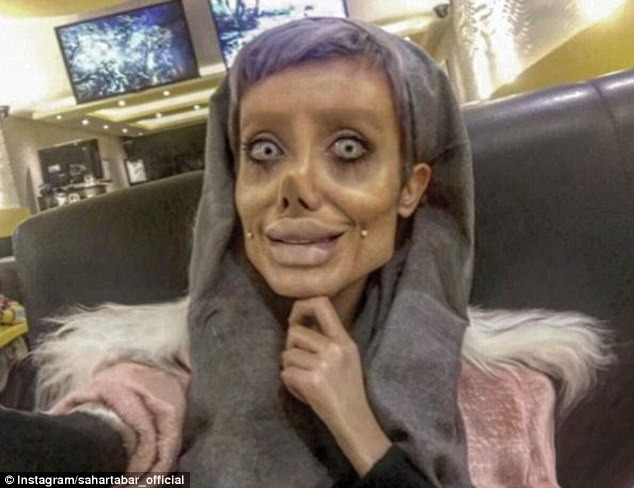 Iranian Angelina Jolie fan's astonishing transformation snaps confound the web amid reports she's had FIFTY surgeries to look like her idol (but is it just clever prosthetics?) 46D6485400000578-5132349-Her_followers_have_compared_her_look_like_a_zombie_and_a_corpse_-a-8_1512048177067
