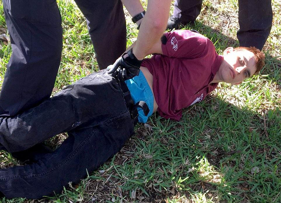 Marjory Stoneman Douglas High School shooting in Parkland, Florida. - Page 7 49394AE000000578-5392559-Nicolas_Cruz_19_was_arrested_after_he_stormed_Marjory_Stoneman_D-m-1_1518657645987