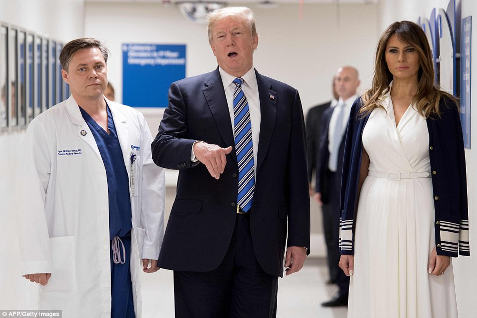 The Serious Side - part 4 - Page 13 494D4DAF00000578-5402363-President_Donald_Trump_speaks_with_doctor_Igor_Nichiphorenko_L_a-a-157_1518851458131