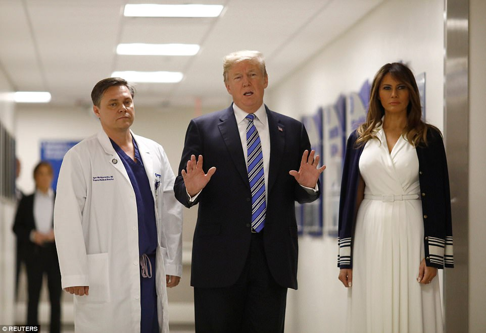 The Serious Side - part 4 - Page 13 494D509F00000578-5402363-President_Donald_Trump_and_first_lady_Melania_Trump_visit_with_D-a-154_1518851458126