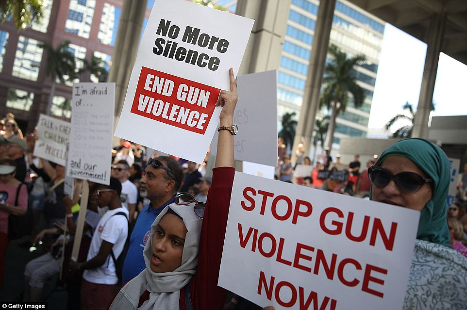 The Serious Side - part 4 - Page 13 4953BAE000000578-5404059-People_join_together_on_Saturday_to_call_for_new_gun_laws_after_-a-59_1518901407587