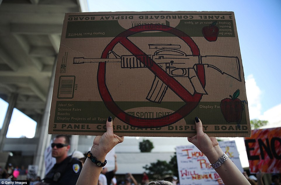 The Serious Side - part 4 - Page 13 4953BBA700000578-5404059-Many_protesters_called_for_the_banning_of_assault_weapons_at_the-a-65_1518901407814