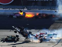 Off Topic for this Forum-Dan Wheldon dies in huge crash at IndyCar finale Abc986ea-6756-4e62-99d1-9d5402fc11a5-Dan-Wheldon-dies-in-huge-IndyCar-crash-6PFRORM-x