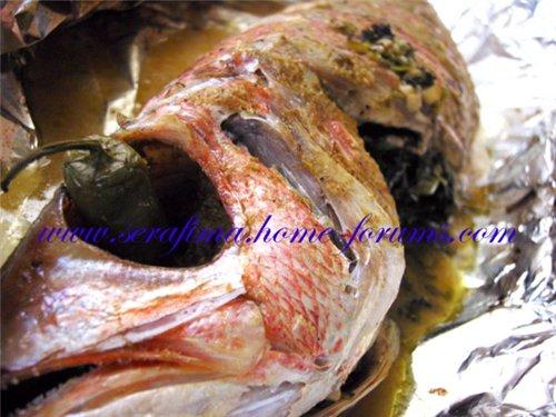 Рыба фаршированная петрушкой и чесноком 963d0f86c036