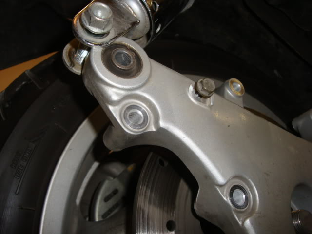 Help with rear tire (swingarm part) removal Shockofftoo