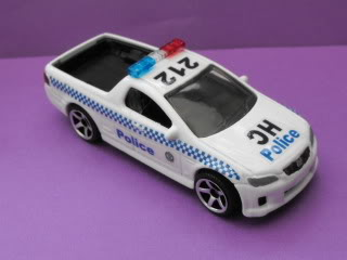Mitsubishi Lancer Evo X Police: Matchbox v/s Tomica. March11038