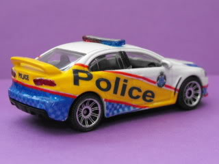 Mitsubishi Lancer Evo X Police: Matchbox v/s Tomica. March11046