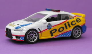 Mitsubishi Lancer Evo X Police: Matchbox v/s Tomica. March11048