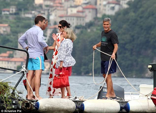 Photos: George Clooney and Amal Alamuddin boating on Lake Como 1407883116516_wps_31_OIC_XCLUSIVEPIX_COM_EXCLU