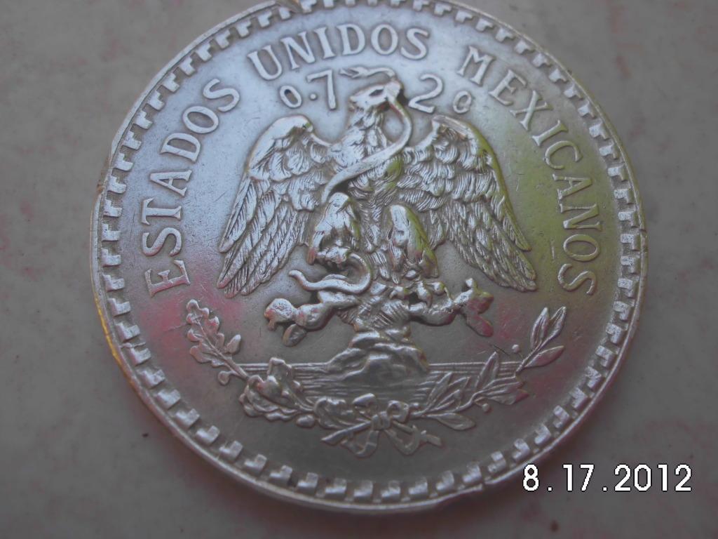 pocas monedas entre ellas una de plata y un anillo de oro CIMG1112