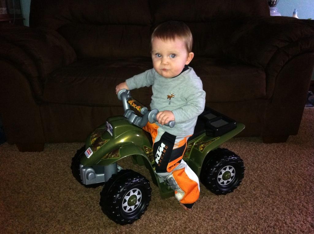 Mason riding his four wheeler!!!  407377C4-2E8E-4241-8769-4EDE528F600D-2676-0000019060C93AA9
