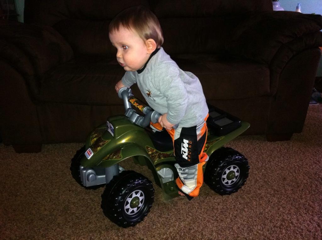 Mason riding his four wheeler!!!  820257E6-F031-48DF-8D50-5E0410DE58D5-2676-000001905847D0DD