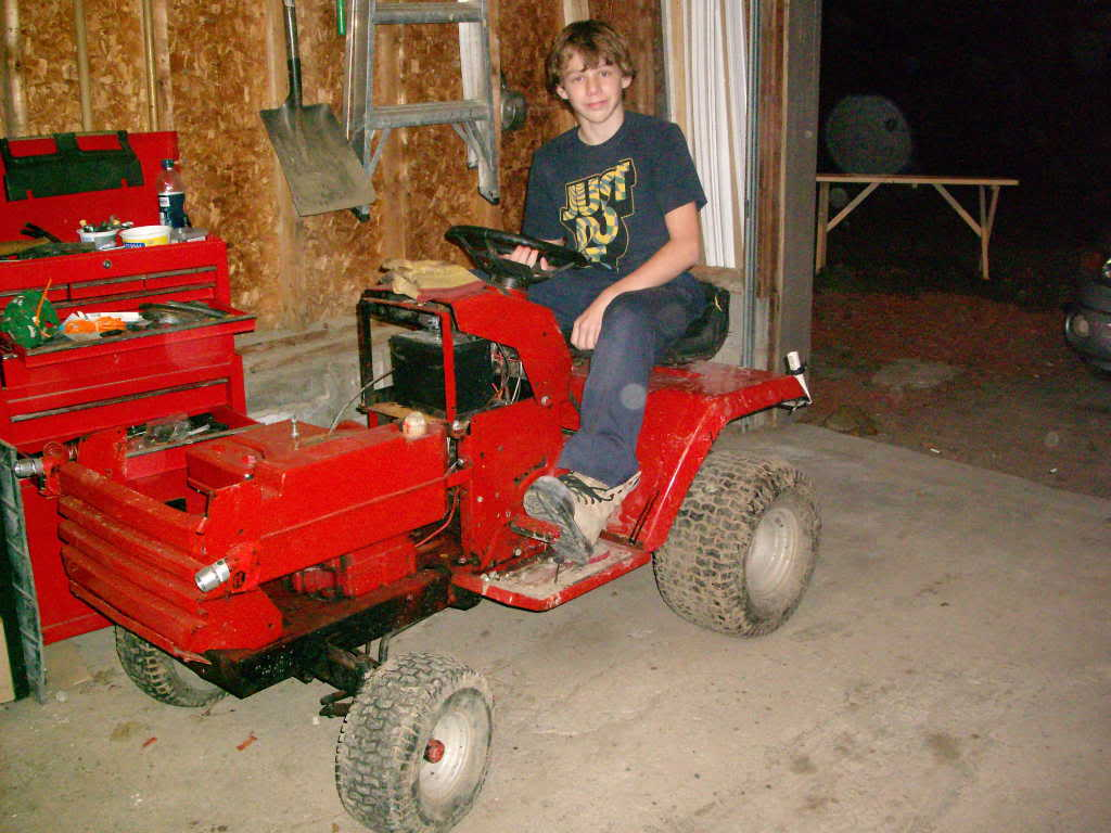 me on my tractor and old pulleys GEDC2455