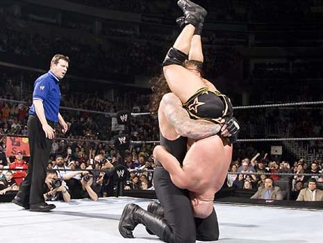 Undertaker ataca a Aj styles y a Edge Wwe-undertaker-scroll3