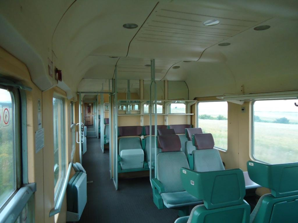 BDŽ-Bulgaria - Pagina 19 An_interior_of_second_class_passenger_car_of_class_11_06_2011_zps4516b293