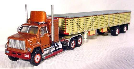La Capsula del Tiempo (camiones GMC) Gmc_brigadier_stake_trailer