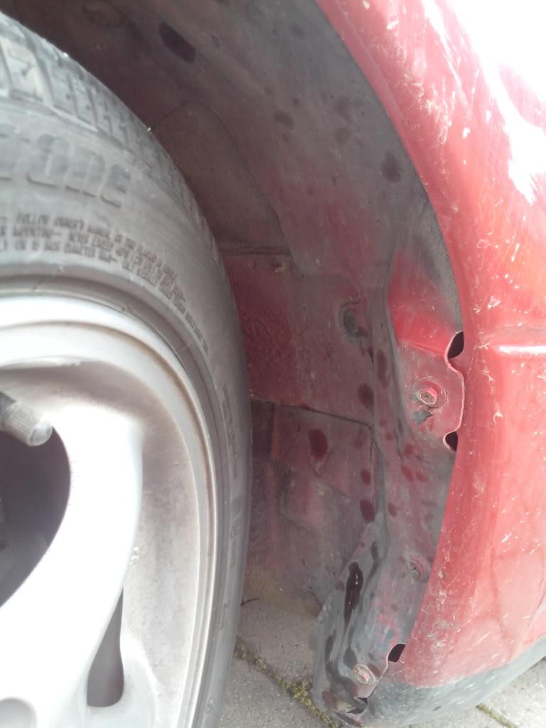 """""""Parafangos"""" interior del paso de rueda IMG_20130329_111727_zpsda601dce"""