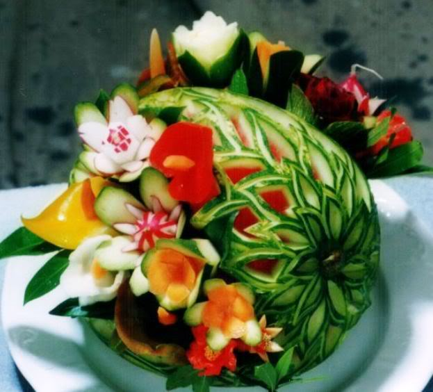 Arte en sandías y frutas.  FLORESVERD