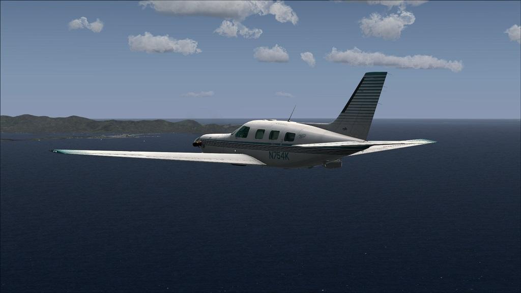 Voo TNCM com carenando Piper 46T Malibu 10_zps790c0996