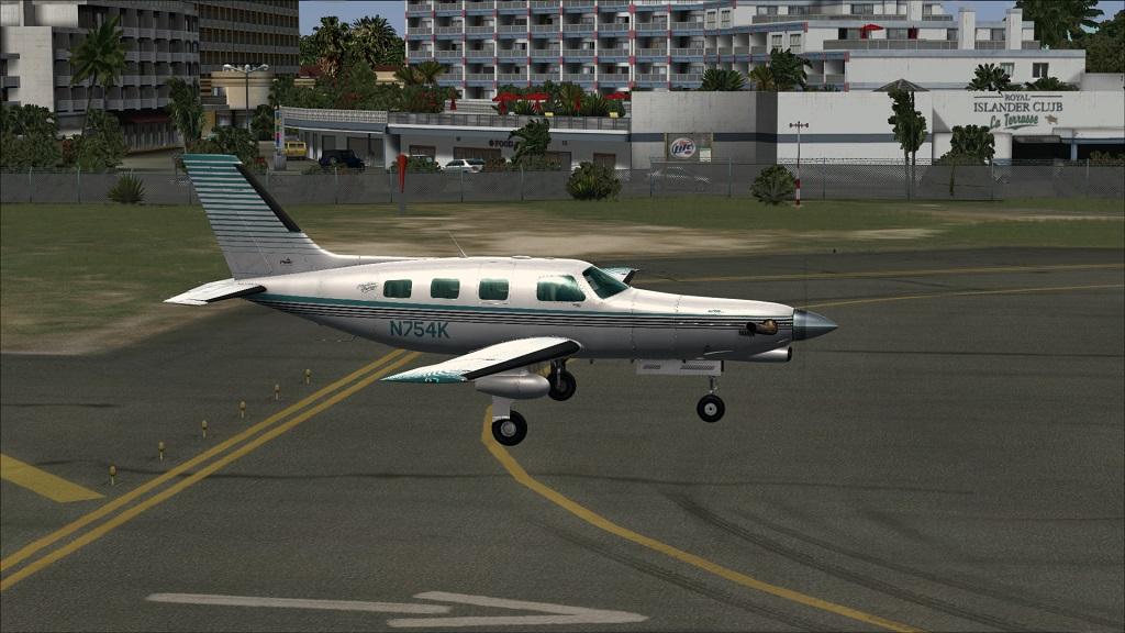 Voo TNCM com carenando Piper 46T Malibu 16_zps53fa72ec