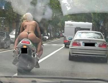 Lets get this section started with a hot girl on a motorcycle! Funny_pictures_Bikini_Motorcycle