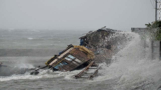 'Worse than hell' in typhoon-ravaged Philippines  131108030403-wave-typhoon-house-horizontal-gallery