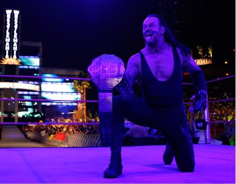 TAKER WORLD CHAMPION AND TAG TEAM CHAMPION Undertaker