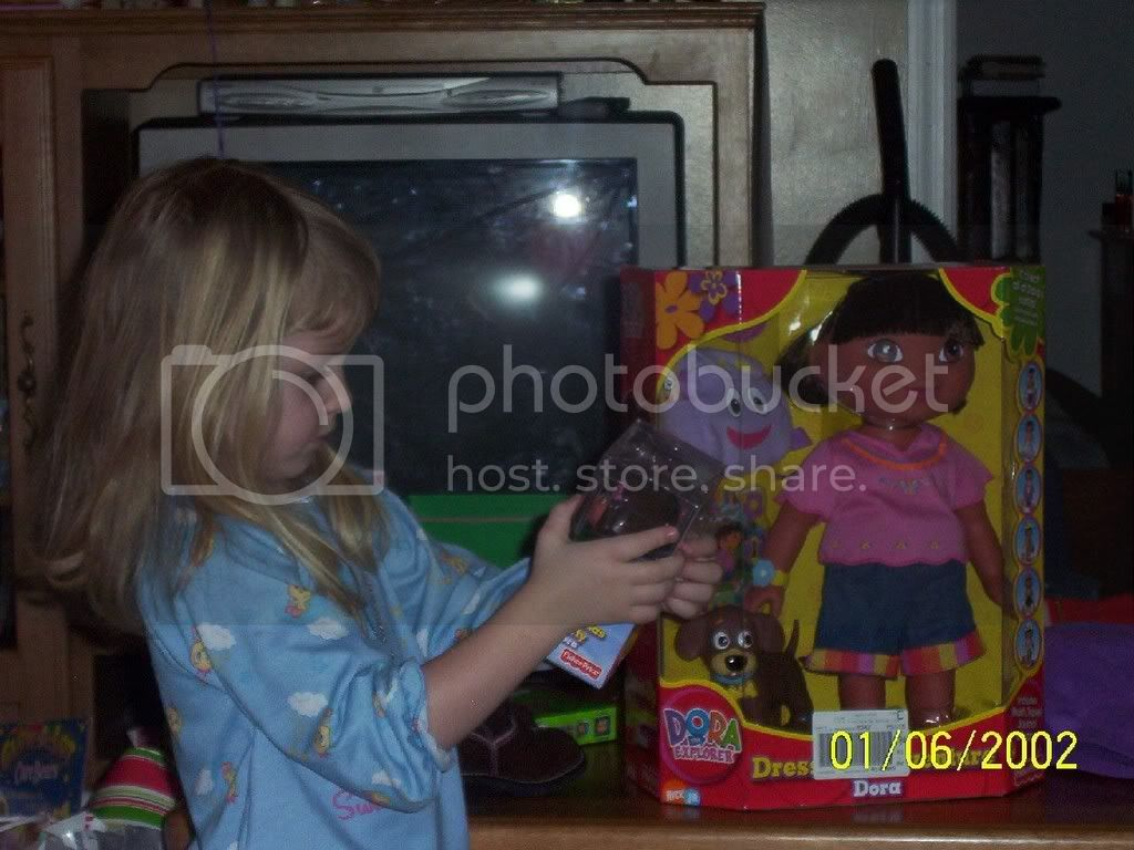 enjoy the pics of my 4 year old sister..... AverylookingathergiftsfromChristmas