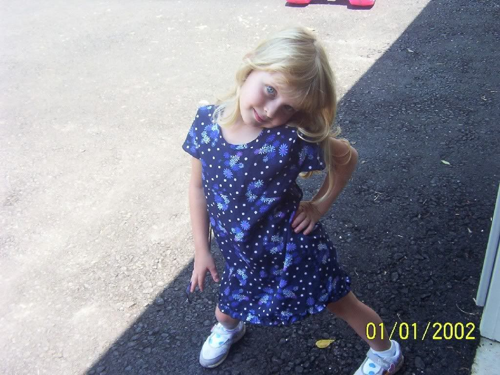 enjoy the pics of my 4 year old sister..... Adorable-2