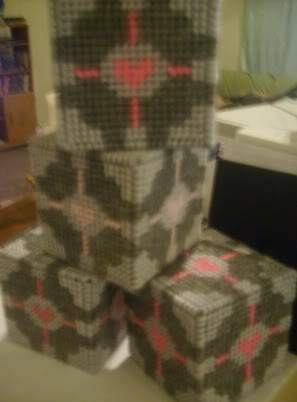 Dar's companion cubes out of plastic canvas Companioncubes