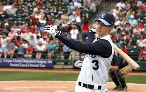 justin on the set of the open road with a base ball uniform 13zty1j