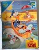 Les puzzles 80's de D.A, séries ou de  gamme de jouets.... Th_Donald01