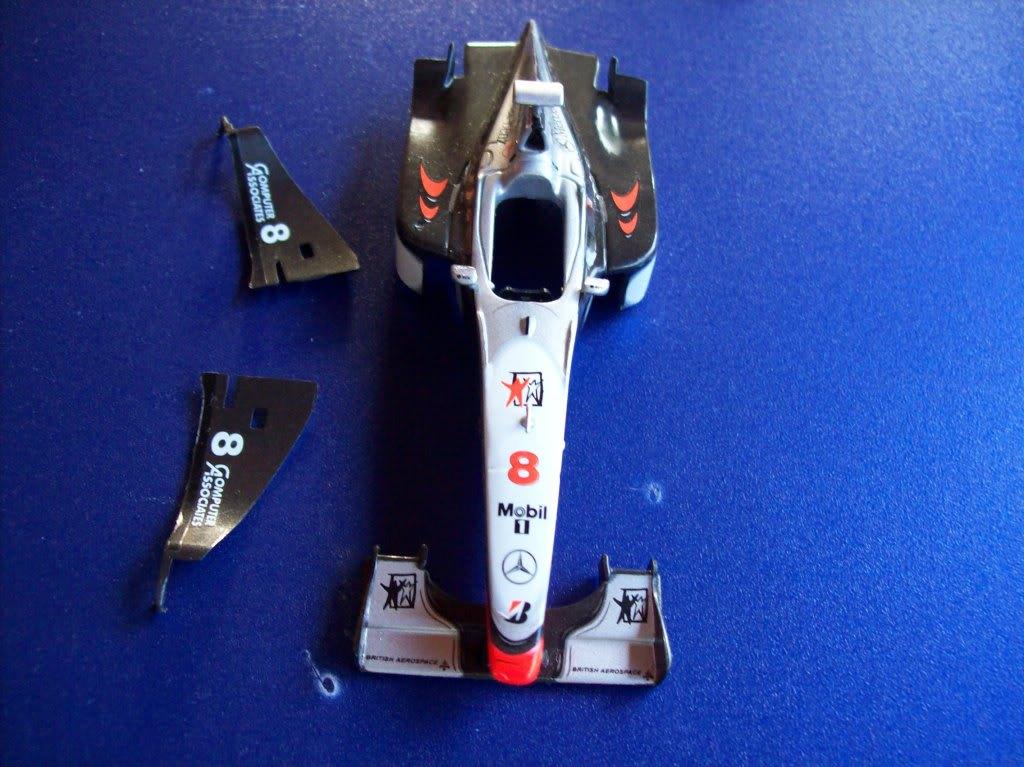 Extrayendo pilotos de réplicas F1 escala 1/43 Keke5019