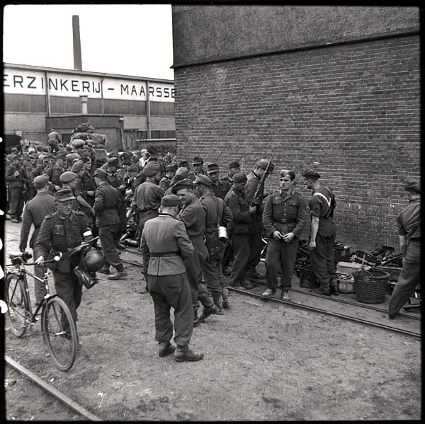 The liberation of The Netherlands Germansoldiersbeingdisarmedbytroops