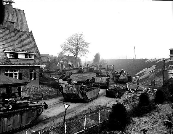 The liberation of The Netherlands LoadingcarriersintoBuffaloesandBuff