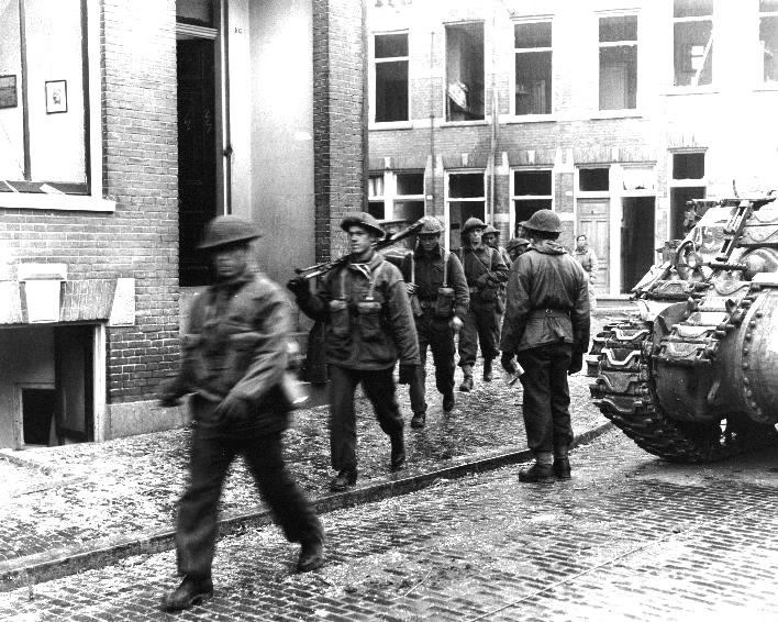 The liberation of The Netherlands SoldiersofthePerthRegimentmovethrou