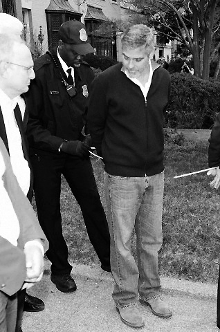 George Clooney arrested in Washington DC, March 2012 - Page 4 Protest4