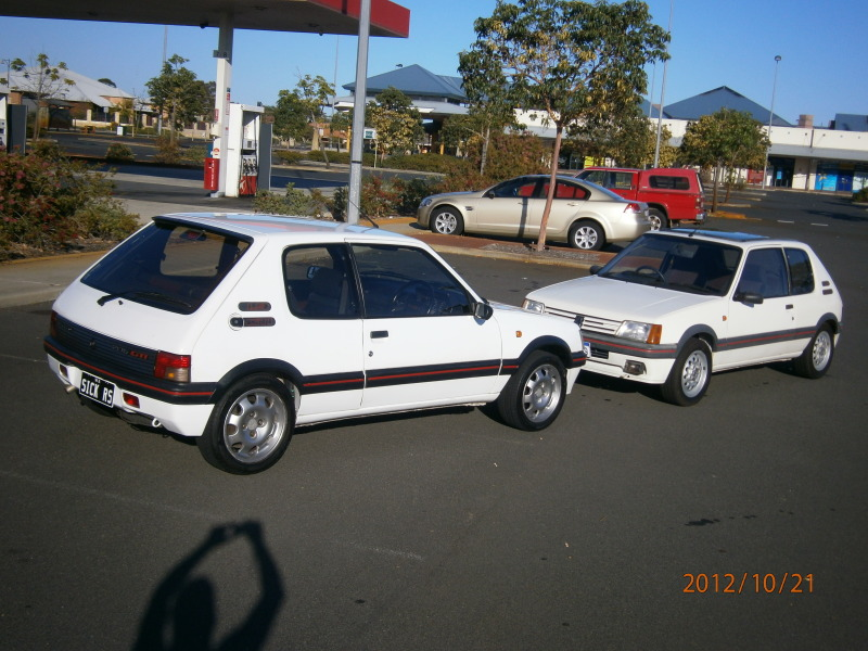 My other car lol 205 gti and my 207 gti next to it.. 004-4