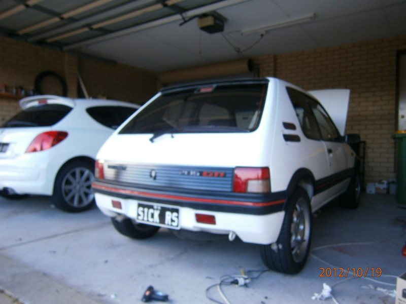 My other car lol 205 gti and my 207 gti next to it.. 091