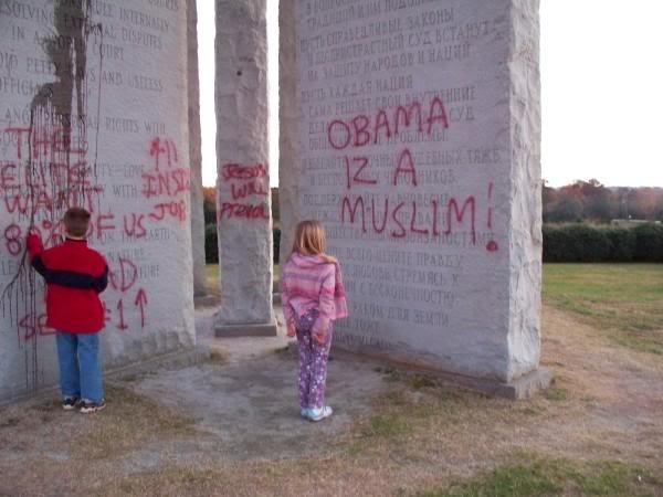 Georgia Guidestones have been vandalized Ggdefaced-2