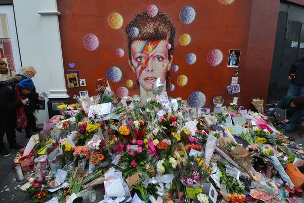 David Bowie has been secretly cremated without a funeral or any family and friends present  Fans-and-wellwishers-gather-to-pay-tribute-to-David-Bowie-at-a-mural-in-South-London