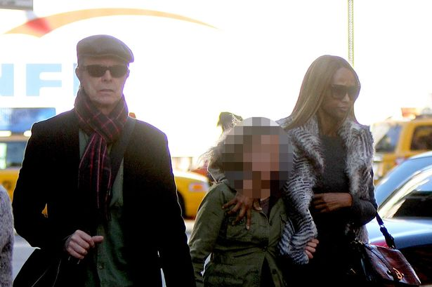 David Bowie has been secretly cremated without a funeral or any family and friends present  PAY-David-Bowie-with-wife-Iman-and-daughter-Alexandria-Zahra-Jones
