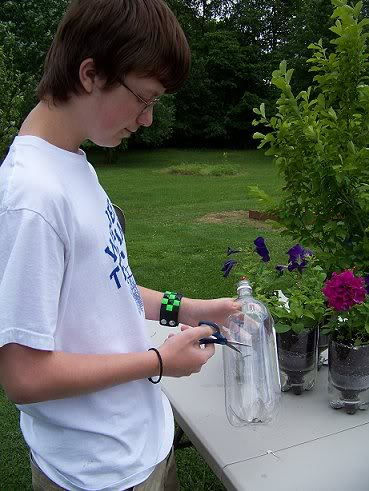 recycled self watering containers for plants Soda1-1
