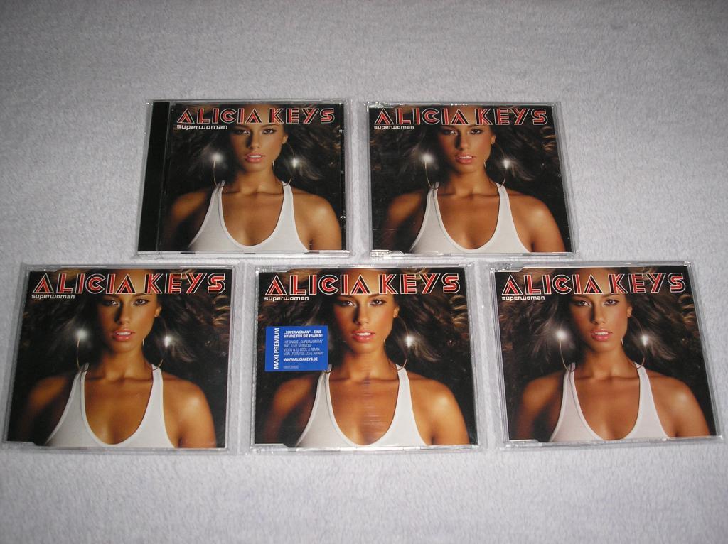 Tu colección de Alicia Keys - Página 15 P1010147_zps40147c04