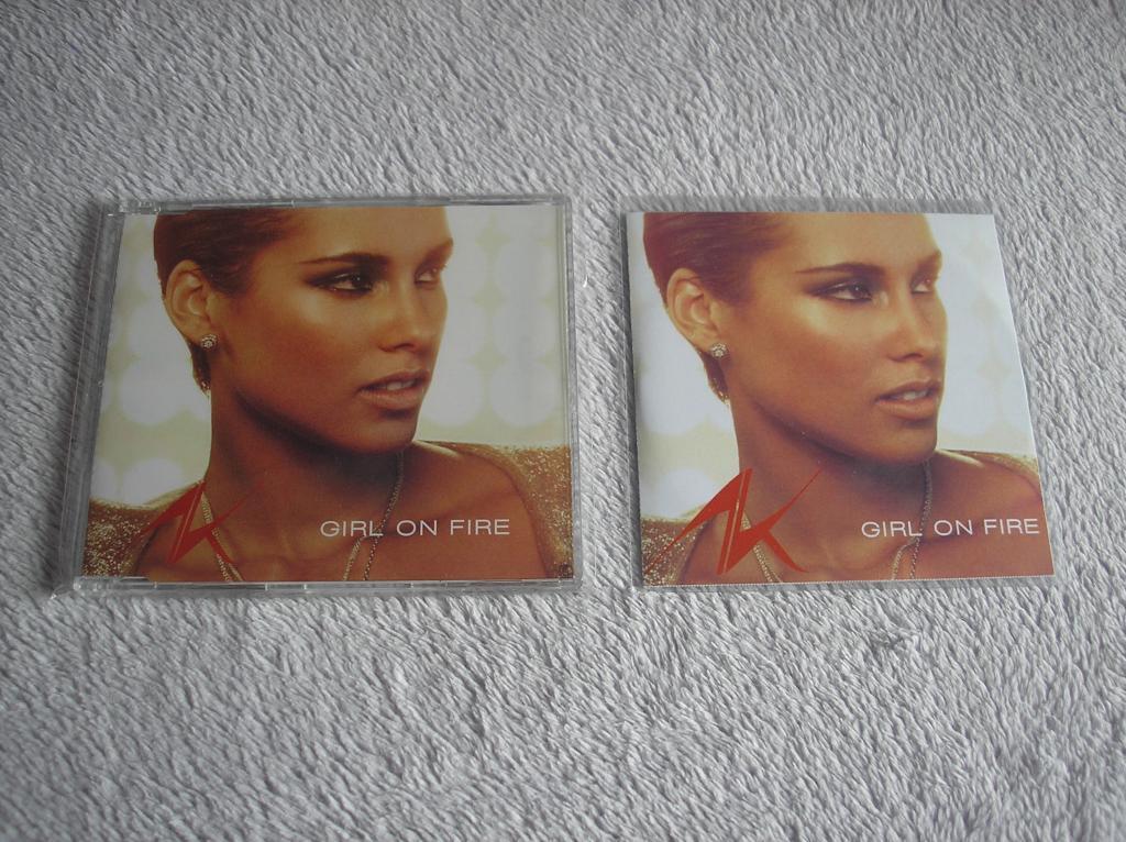 Tu colección de Alicia Keys - Página 15 P1010191_zpsa095cd11