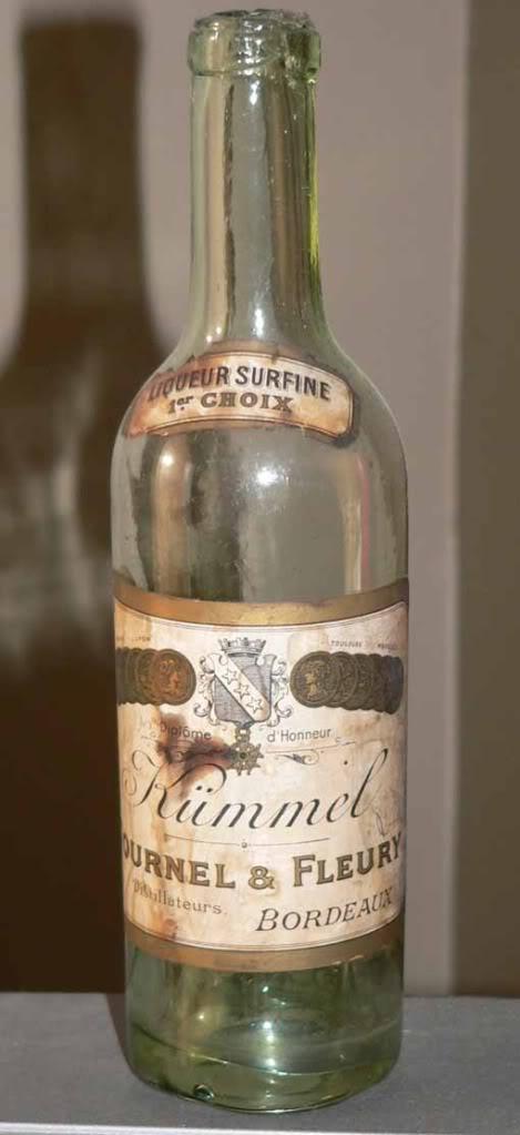 Une bouteille verte bimal a fond creux 9 oz  Petit-vin