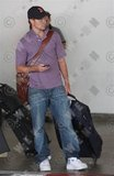 [06-22-09] Brian collecting his luggage at LAX Th_4368970_preview